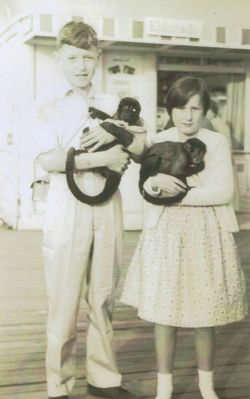 Douglas and me on holiday in Morecambe pictured holding live monkeys.