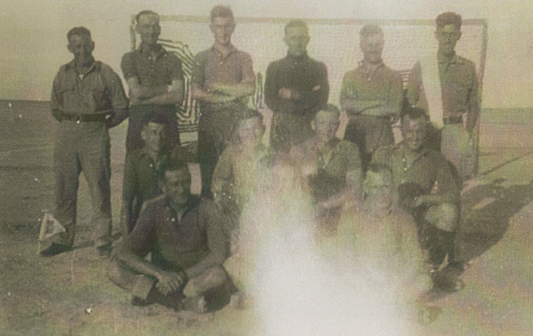 My Dad (in the back row far right) photo taken in Iraq during the War.
