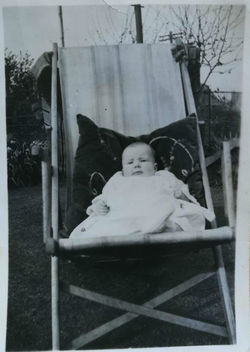 Me as a baby aged 5 months sitting in a deck chair.