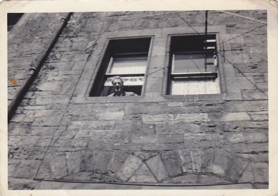 My dad pictured looking out of our living room window from our Well Court House