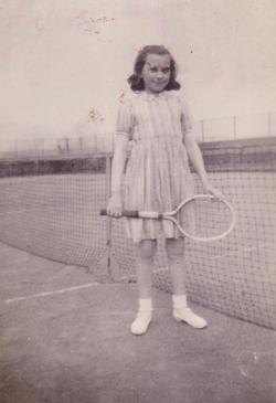 Girl With Tennis Racquet Standing At Net 1949