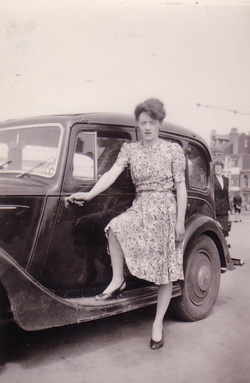 Young Woman Standing By Running Board Of Car 1947