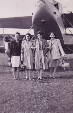 Group Of Women Standing By Aeroplane Before/After Flight 1947