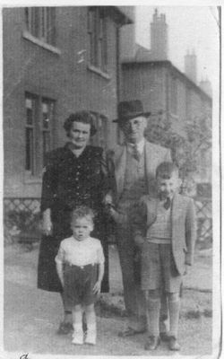 Grandparents Standing With Grandchildren In Back Garden c.1942