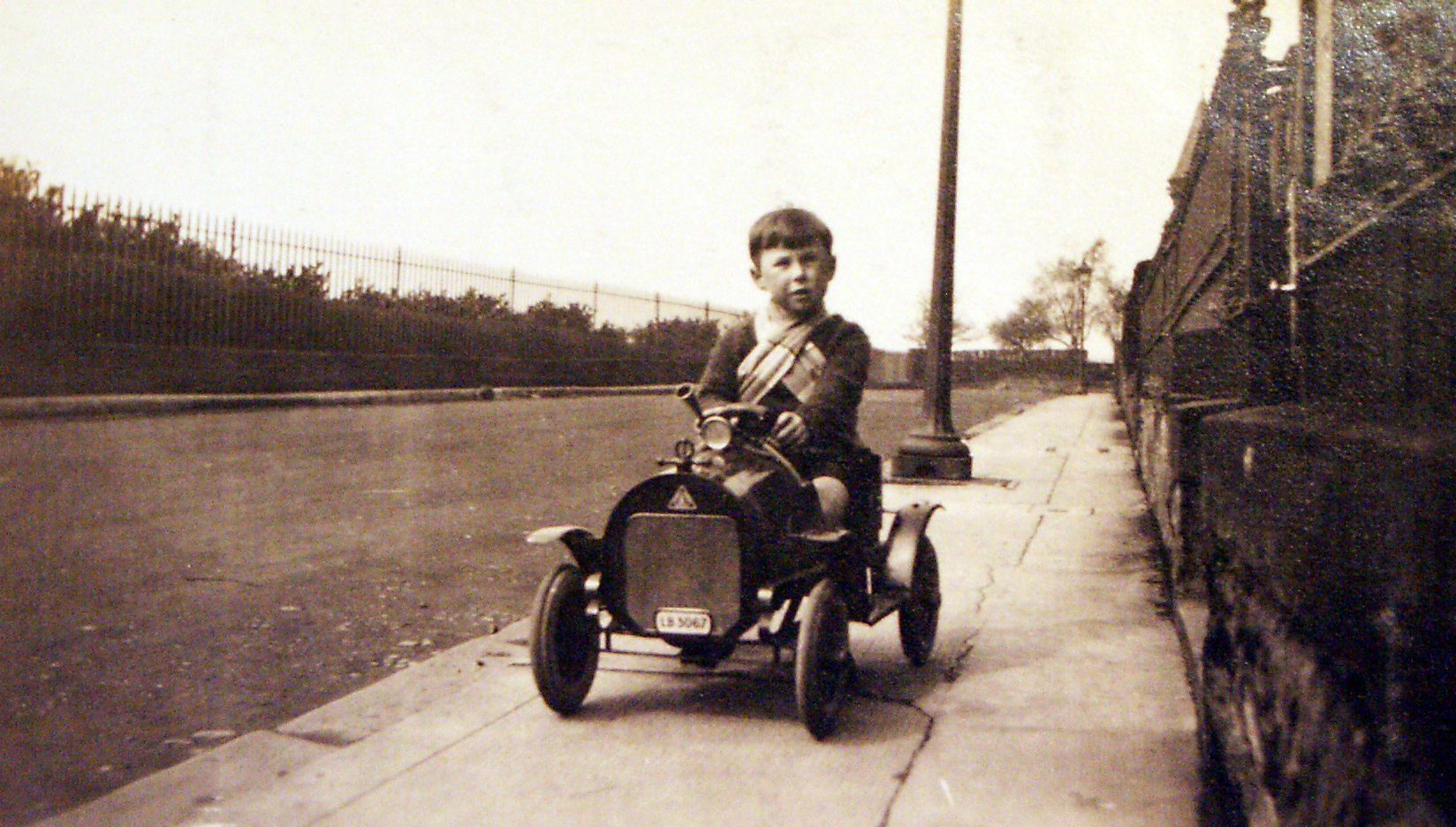 Young Boy Driving Pedal Car Along Pavement c.1932