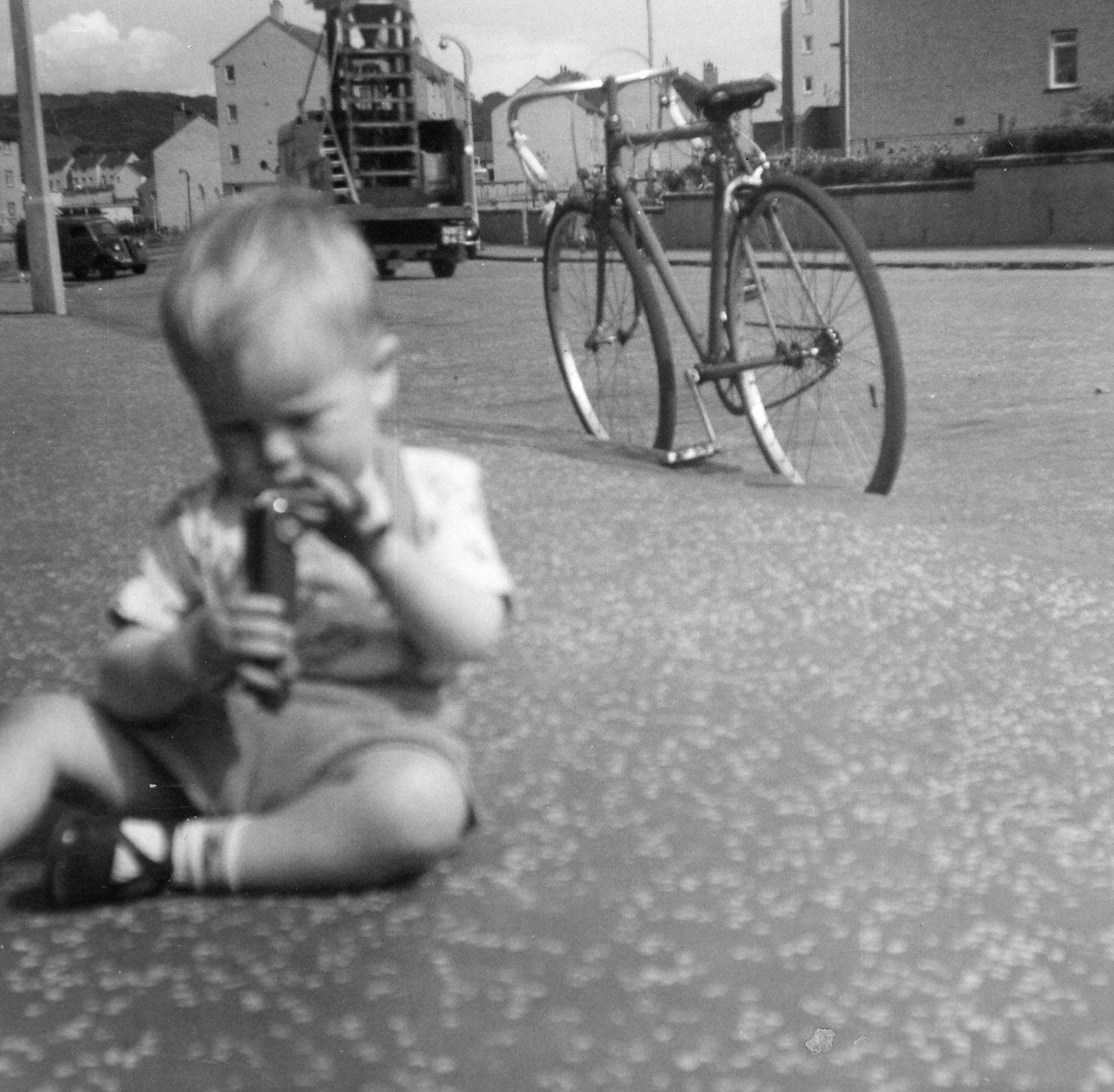 Toddler sat on pavement, Oxgangs