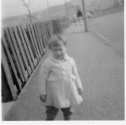 Young child standing in the street, Oxgangs