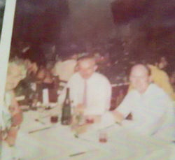 Sitting down to evening dinner again in Yugoslavia.