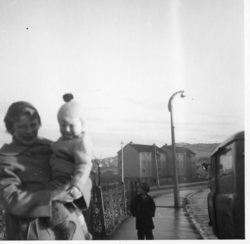 Family standing in the street in Oxgangs