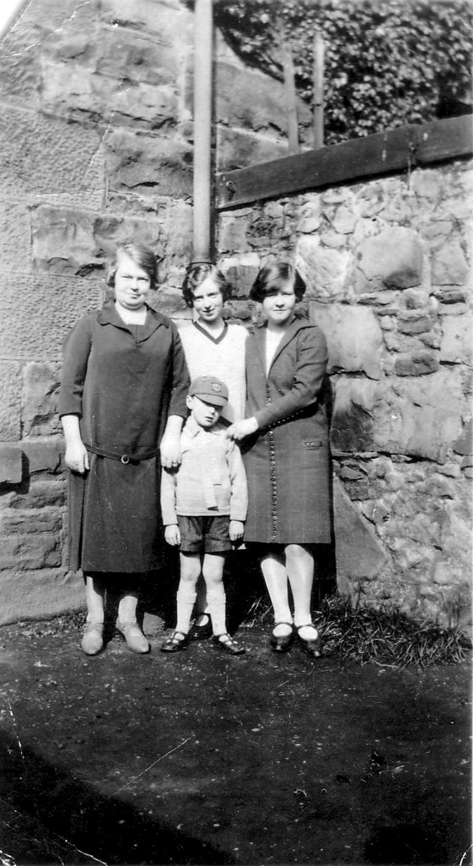 Three Women And Boy Standing In Corner Of The Garden 1930s