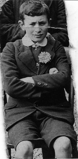 Schoolboy Sitting With Arms Crossed c.1914
