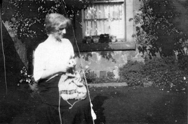 Woman Knitting In The Garden 1930s