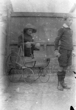 Two Boys In Back Street With Home Made Cart c.1913