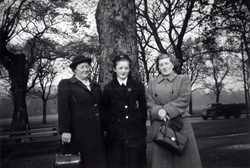 Schoolgirl With Mother And Cousin Standing By Tree In The Meadows, Oct 1950