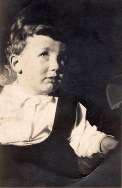 Close Up Young Child In Pram 1930s