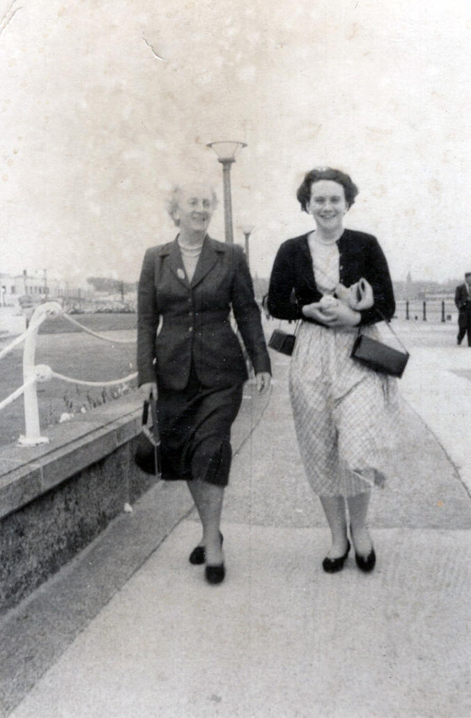 Mother And Daughter Walking Along Seafront c.1955