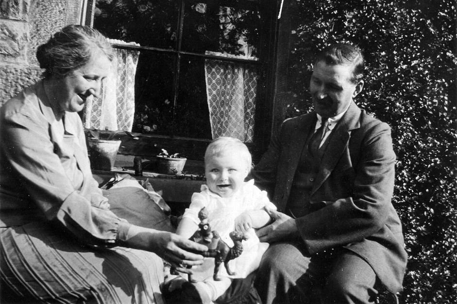 Couple With Young Son Sitting Outside Their House In Eskbank c.1930