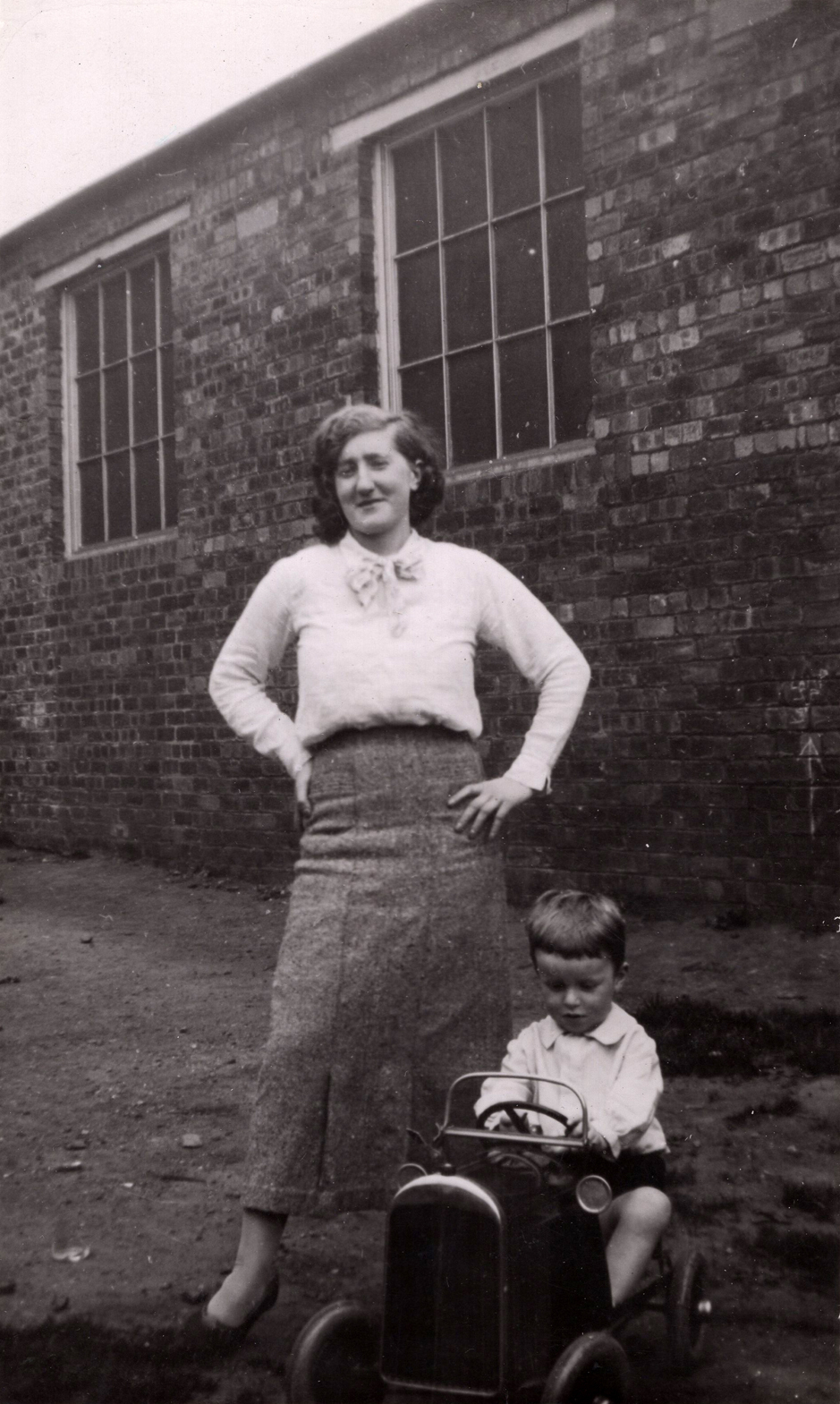 Woman With Young Boy In Pedal Car Outside Ramsay Technical College c.1937