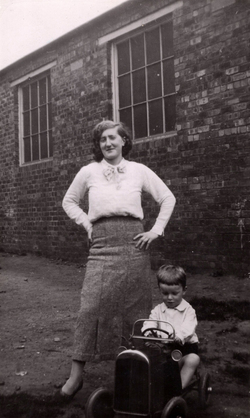 Woman Outside Ramsay Technical College With Young Boy In Pedal Car c.1937