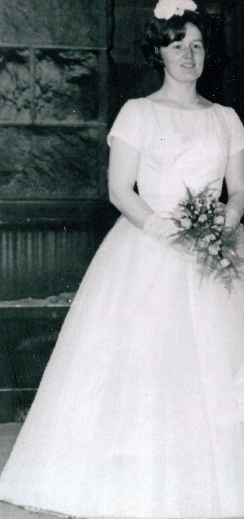 Bridesmaid Holding Bouquet Of Flowers c.1960