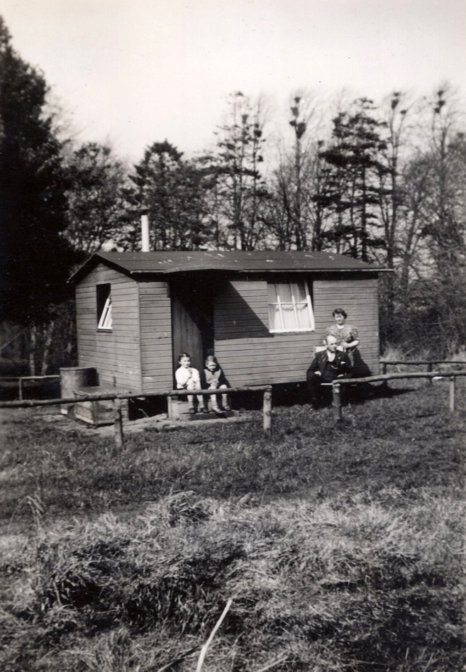 Family Sitting Outside Cabin At Balerno c.1945
