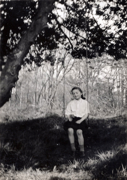 Girl Sitting On Swing Under Holly Tree c.1945