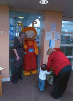 Bookbug and friends in the doorway to Oxgangs Library