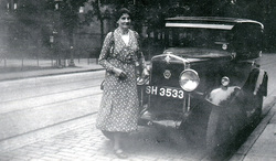 Woman Standing By Front Of Car, early 1920s