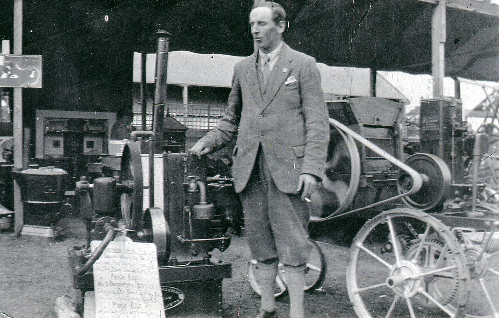 Engineer Standing With Display Of Working Motors c.1930