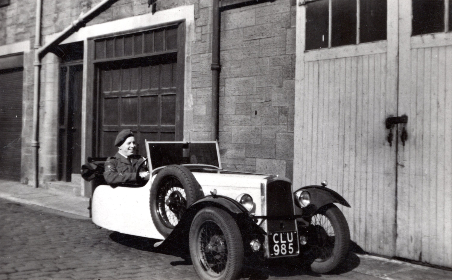Young Man In Cadet Uniform Behind Wheel Of Three Wheeled Car In Thirlestane Lane c.1950