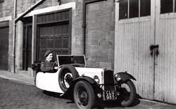 Young Man In Cadet Uniform Behind Wheel Of Three Wheeled Car In Thirlestane Lane c.1950