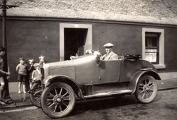 Man Stting Behind Wheel Of Car Children Looking On 1920s