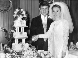 Young Couple Cutting The Wedding Cake, July 1969