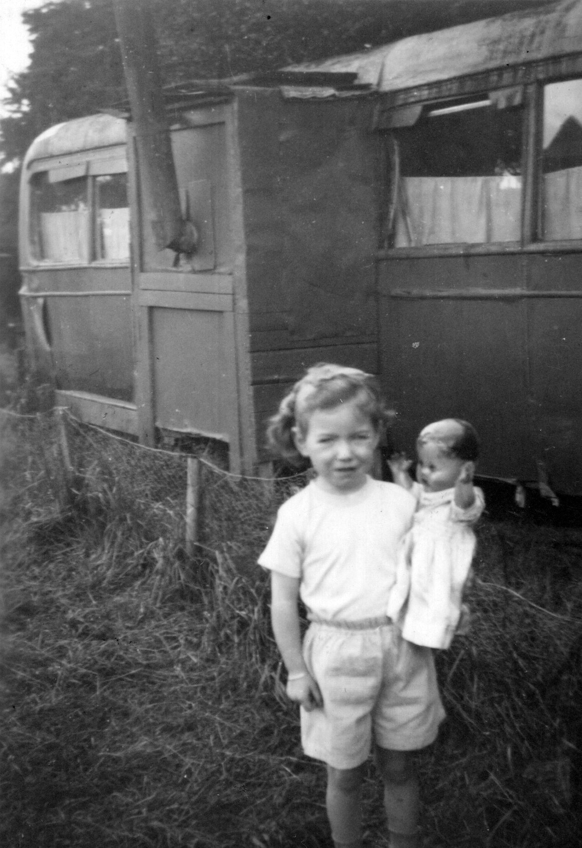 Young Girl With Doll Outside Caravan At Howgate, Penicuik 1953