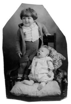 Studio Portrait Young Boy Standing On Chair With His Baby Brother Sitting 1933
