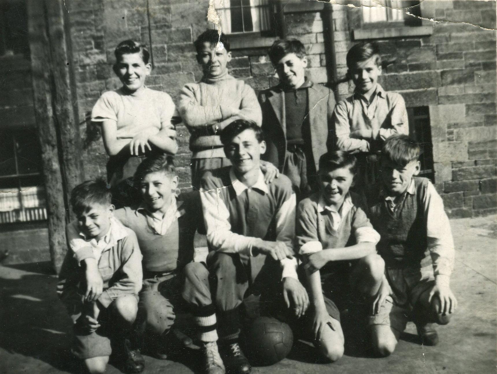 Group Of Boys Playing As Ballantyne Football Team 1950