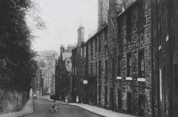 Just past the Newsagent's Shop Sign, attached to the Tenement, is where I was