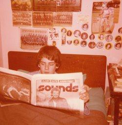 Boy reading 'Sounds' magazine, Oxgangs