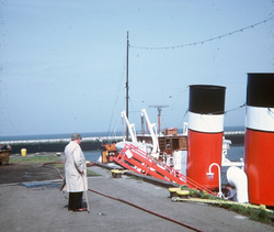 Man Standing At Granton Harbour By The Funnels Of PS Waverley 1980s