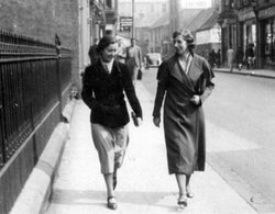 Two Women Walking Along Newhaven Main Street 1950s