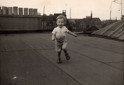 Young Boy Running About On Tenement Rooftop Drying Green c.1960