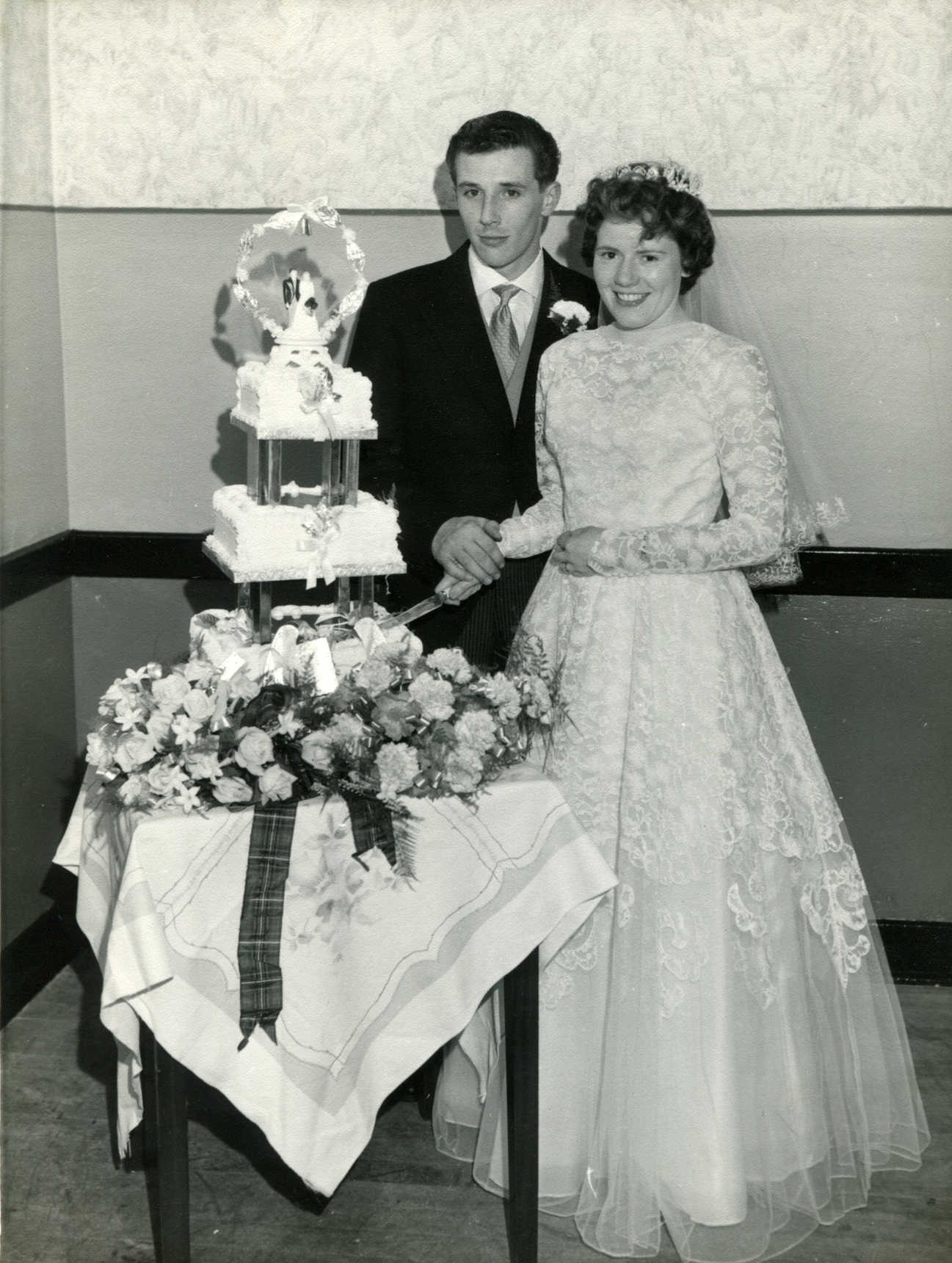 Bride And Bridegroom Cut The Wedding Cake 1958