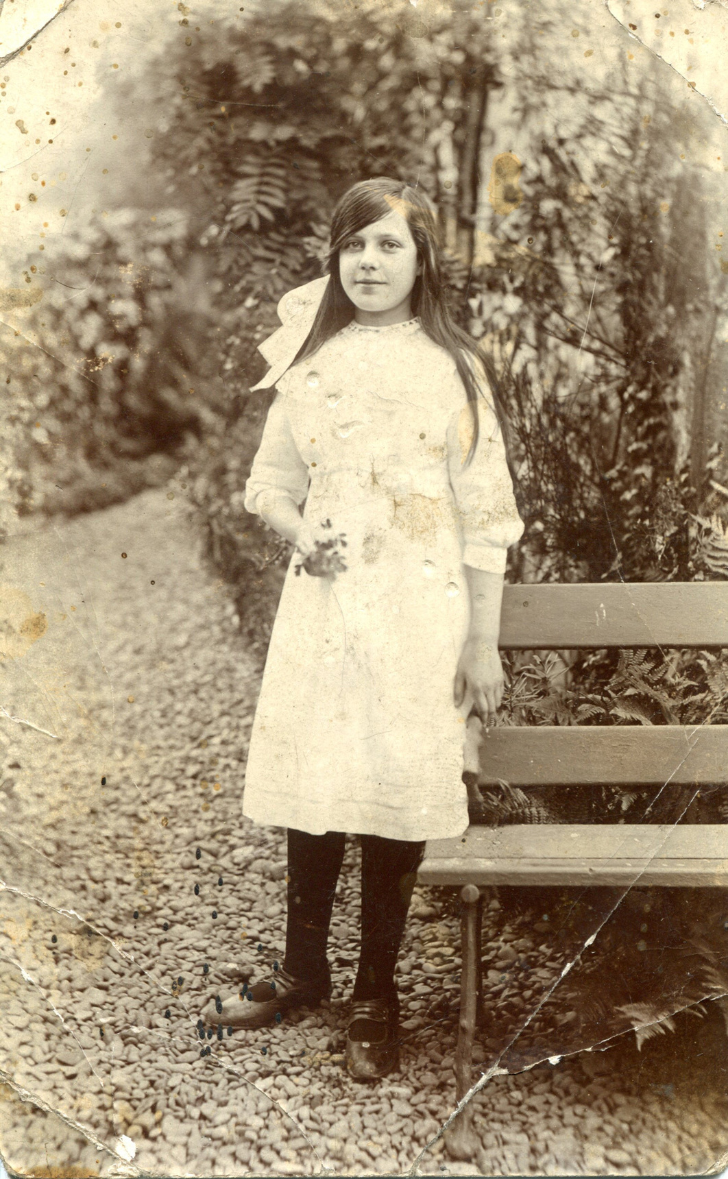 Girl Standing By Bench On Garden Path 1910s