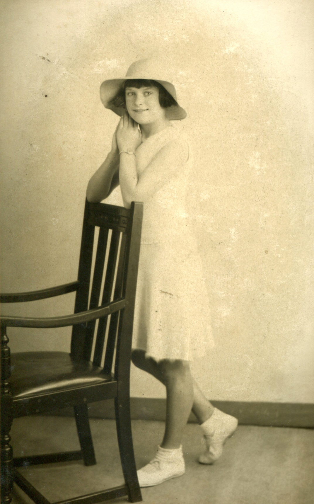 Studio Portrait Girl Leaning On Back Of Chair c.1933