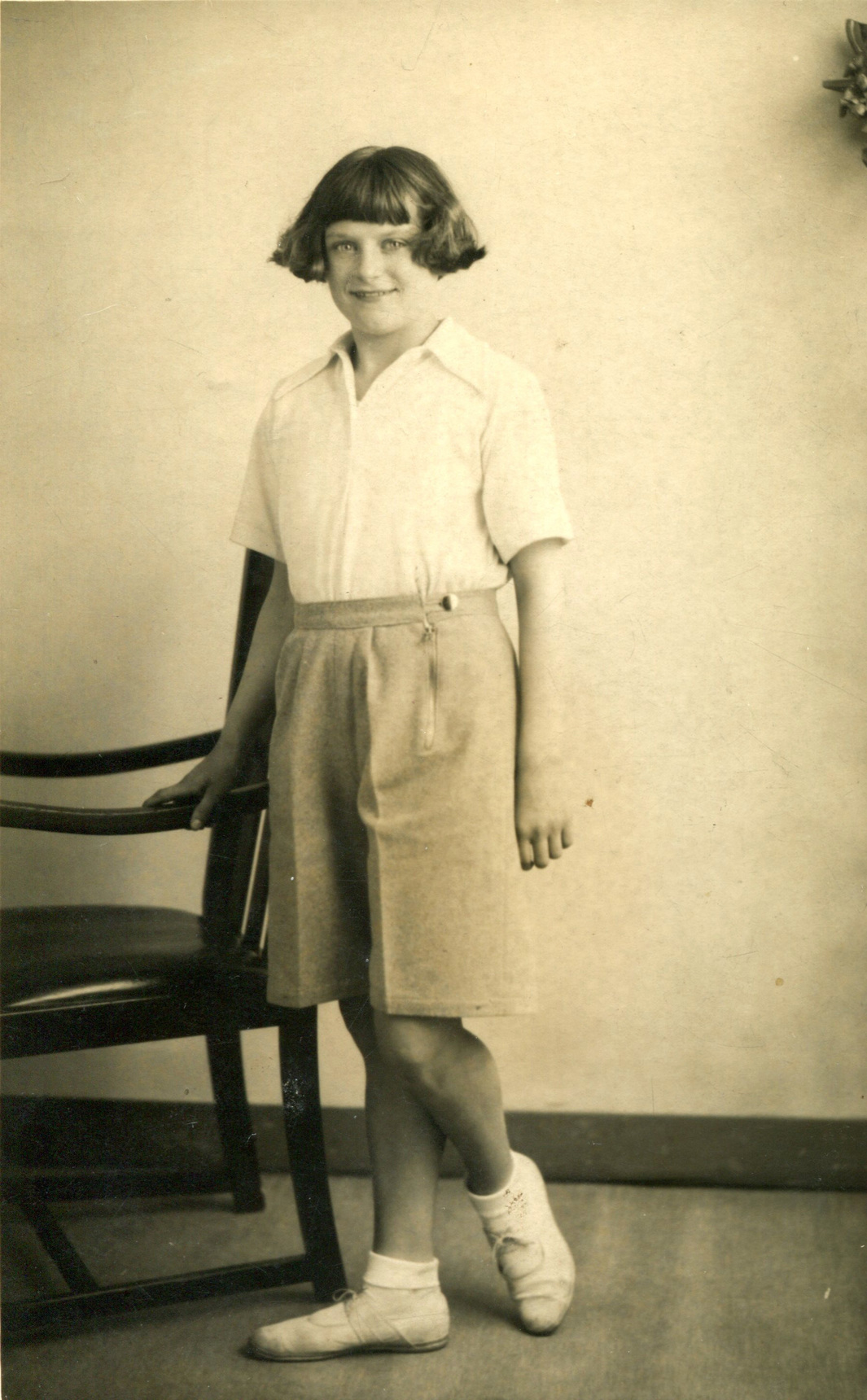 Studio Portrait Girl In Shorts By Chair c.1933