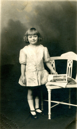 Studio Portrait Young Girl With Magazine And Chair c.1927