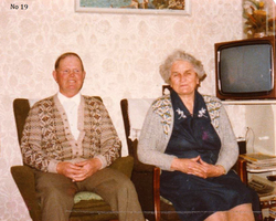 Couple Sitting In Armchairs By The Television Set, July 1978