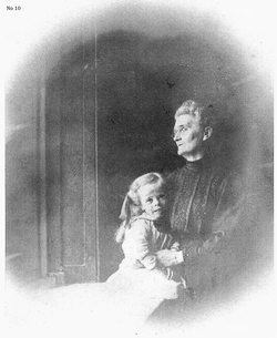 Woman With Young Girl Sitting By Window 1900s