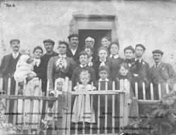 Shetland Family Standing By Gate c.1906