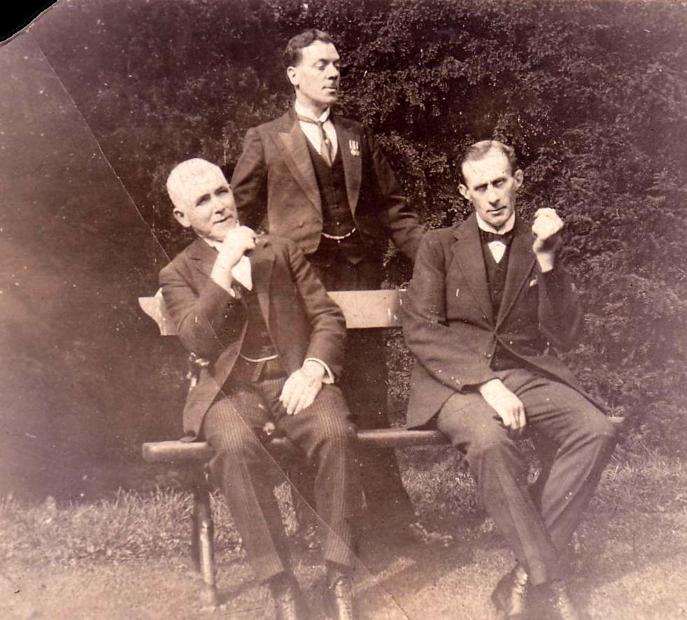 Three Gentlemen Sitting On Outdoor Bench 1920s